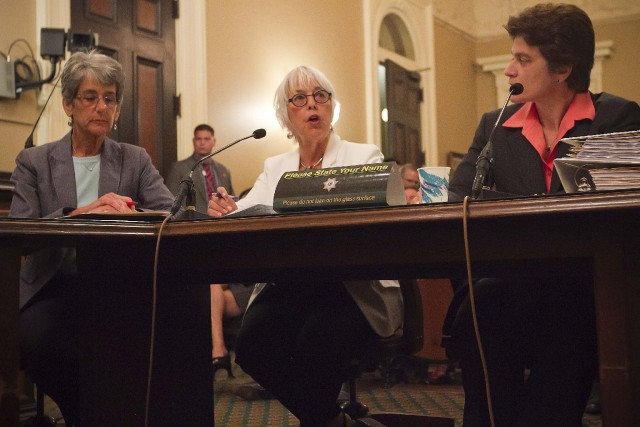 California Senator Hannah-Beth Jackson (left) and California State Auditor Elaine Howle (right ) listen as California Assemblymember Bonnie Lowenthal asks the state's legislative audit committee to look into the practice of sterilization of female inmates. (Randy Allen / The Center for Investigative Reporting)