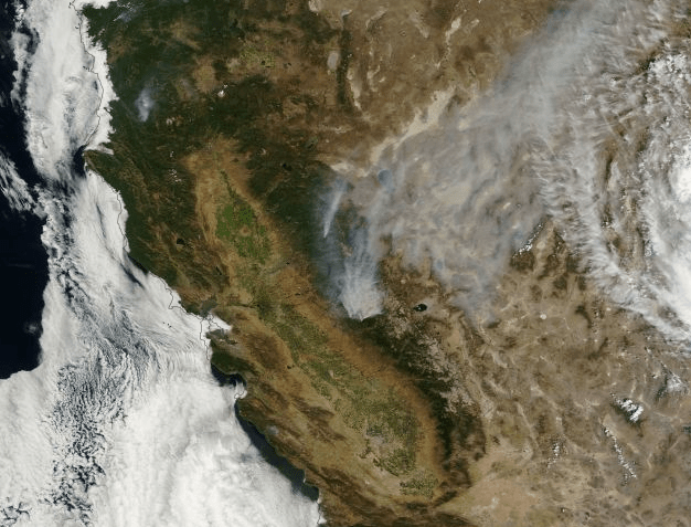 An August 23, 2013, NASA image showing smoke plumes blowing north/northeast from Rim Fire outside Yosemite National Park (NASA Worldview image).