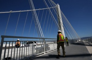 A worker walks on the bike path next to the new Bay Bridge self-anchored suspension tower. After nearly 12 years of construction and an estimated price tag of $6.4 billion, the new eastern span of the Bay Bridge will open tonight. The new self-anchored suspension tower is the world's largest. (Justin Sullivan/Getty Images)