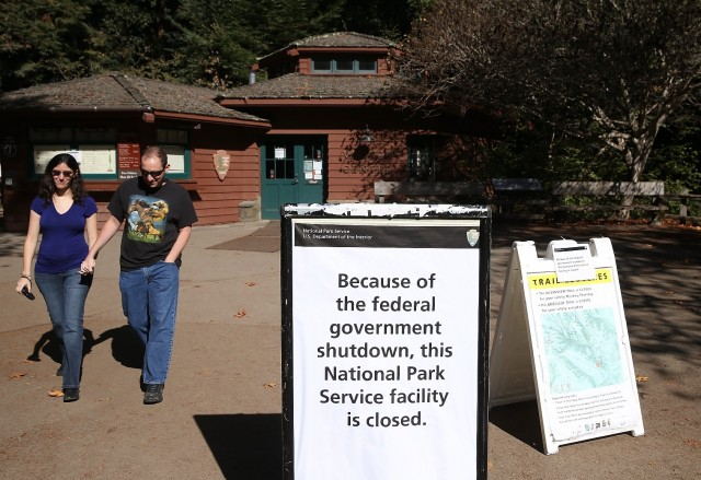 A couple leaves Muir Woods in Marin County, one of many National Park Service sites in the Bay Area closed during this month's federal government shutdown. (Justin Sullivan/Getty Images)