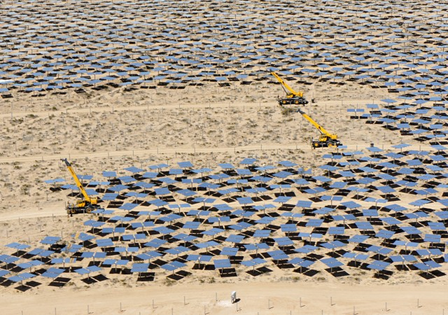 Early this summer, construction continued on the Ivanpah Solar Electric Generating System in the Mojave Desert. Ivanpah, the largest solar thermal power plant in the world, opened this year, putting the state a step closer to its ambitious renewable energy goal. (Lauren Sommer/KQED)