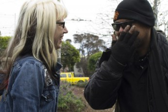 Mary Howe talks to Ulysses, a homeless man who has used the services at the Homeless Youth Alliance, near Stanyan and Haight streets. (Sara Bloomgberg/KQED)