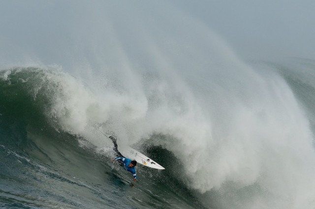 Carlos Burle takes a header  during an early heat in today's Mavericks Invitational in Half Moon Bay. (Ezra Shaw/Getty Images)