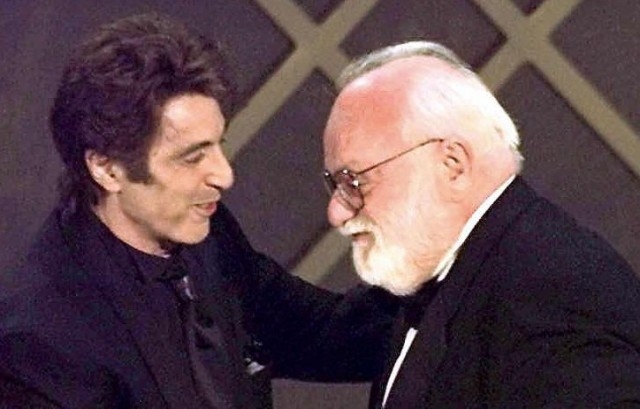 "Actor Al Pacino, left, congratulates film producer Saul Zaentz during 1997 Oscar ceremony in Los Angeles after Zaentz's film ""The English Patient"" was named Best Picture. (Timothy A. Clary/AFP-Getty Images)"