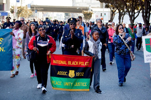 Members of the National Black Police Association sang gospel hymns as they marched down 3rd Street in San Francisco during the annual Martin Luther King Jr. Day march.