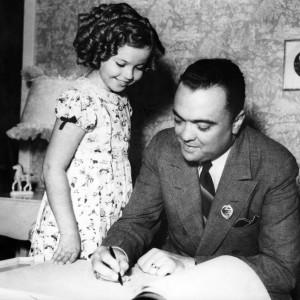Shirley Temple in 1937 with another celebrity, FBI Director J. Edgar Hoover. (AFP/Getty Images)