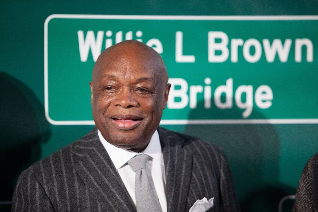 Former San Francisco Mayor and California Assembly Speaker Willie Brown poses with the sign now bearing his name. (Mark Andrew Boyer / KQED)