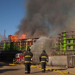 San Francisco firefighters respond to the March 11, 2014, fire at Fourth and China Basin streets. (KQED)