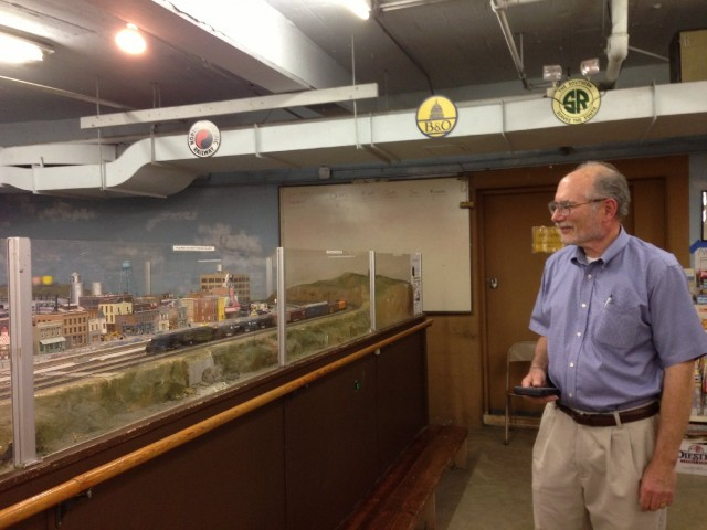 Golden Gate Model Railroad Club Secretary-Treasurer Jim Wilcox running a train on the Golden Gate Model Railroad layout. (Cyrus Musiker/KQED)