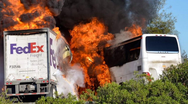 FedEx truck and bus burn on Interstate 5 after Thursday collision. (Jeremy Lockett via KRCR-Redding and Twitter).