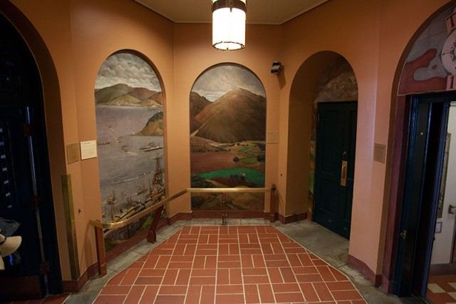 An oil painting by Otis Oldfield covers the walls in the elevator foyer (Mark Andrew Boyer / KQED)
