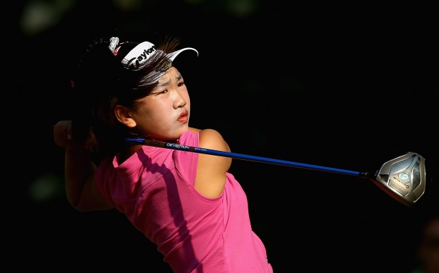 Peninsula sixth-grader Lucy Li watches a shot during a practice round prior to the start of the 69th U.S. Women's Open. (Streeter Lecka/Getty Images)