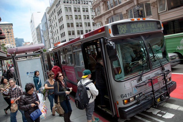 Passengers board the #38 bus on Geary Street, near Union Square. (Mark Andrew Boyer/KQED)