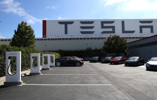 Vehicle charging stations at Tesla Motors plant in Fremont. (Justin Sullivan/Getty Images)