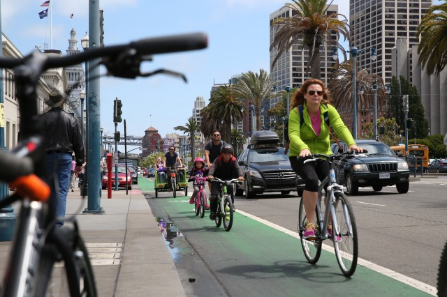 The Embarcadero attracts many bicyclists, as well as cars and pedstrians. (Jeremy Raff/KQED)