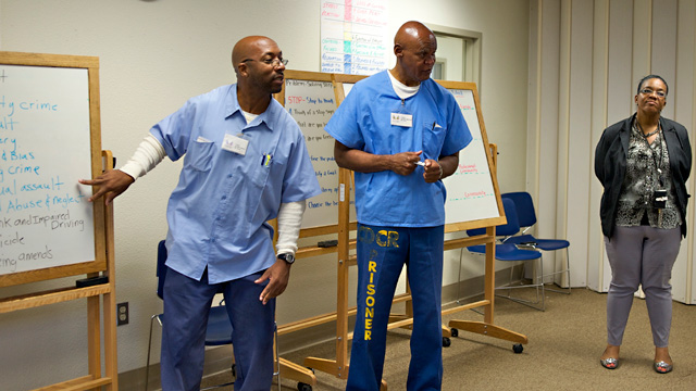 Inmates trained as mentors lead classes as part of the Long-Term Offender Pilot Program at Solano State Prison. (Monica Lam/KQED)