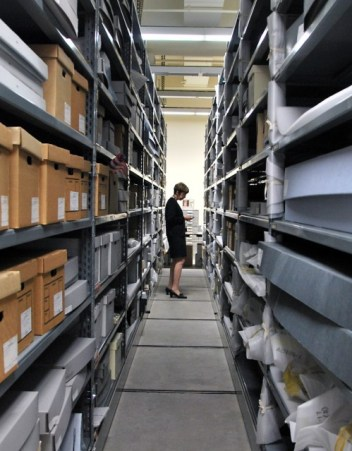 State archivist Nancy Lenoil looks through some of Governor Pete Wilson's records. (Scott Detrow/KQED)