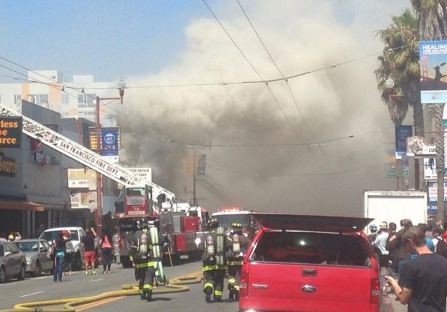 San Francisco firefighters responding to a blaze on Mission Street between 22nd and 23rd streets. (Lee Fang via Twitter)