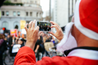 SantaCon, an annual Santa-clad pub-crawl, coincided with the march protesting police brutality.  (Jeremy Raff/KQED)