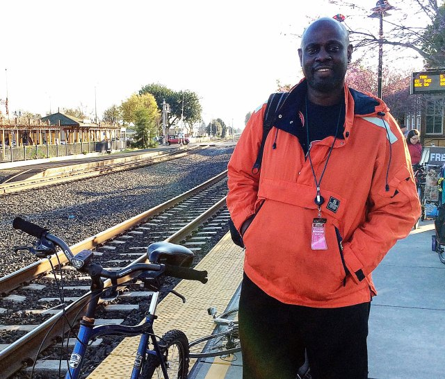 Thomas waits for the Stanford commuter bus at Fremont train station.