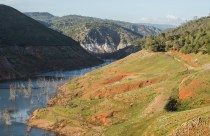 Much of the Stanislaus River canyon, drowned when New Melones Lake filled in the early 1980s, is exposed as the reservoir falls close its lowest point ever.