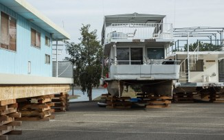 Houseboats docked in a parking lot at Lake McClure as the reservoir has fallen 250 feet below its maximum level. April 2015