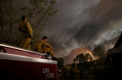 Members of a Cal Fire crew take a break Saturday as the Rocky Fire continued to spread through the countryside east of Clear Lake.