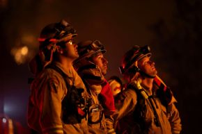 Firefighters monitor a backfire set ahead of the Rocky Fire in the early hours of Sunday, Aug. 2