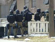 A photo shared on Facebook of police involved in a hostage training scenario at buildings that are scheduled to be demolished at Ida Yarbourgh Apartments in Albany March 21, 2013. Albany police said they're reviewing training procedures after complaints about the proximity of tear gas and the release of fake ammunition to apartments that are still occupied.