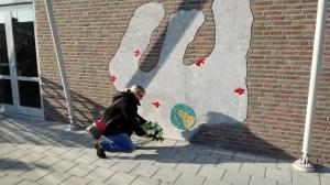 Laying flowers at memorial (2)