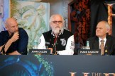 """John Callen sits with his """"Team Oin"""" jacket on during the press conference at Te Papa Museum in Wellington, New Zealand. Each actor choose a unique approach to wardrobe, just as in the movie, showing their personality when there was little dialog to go around."""