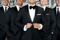 Groom in a bow tie and groomsmen in a tie?