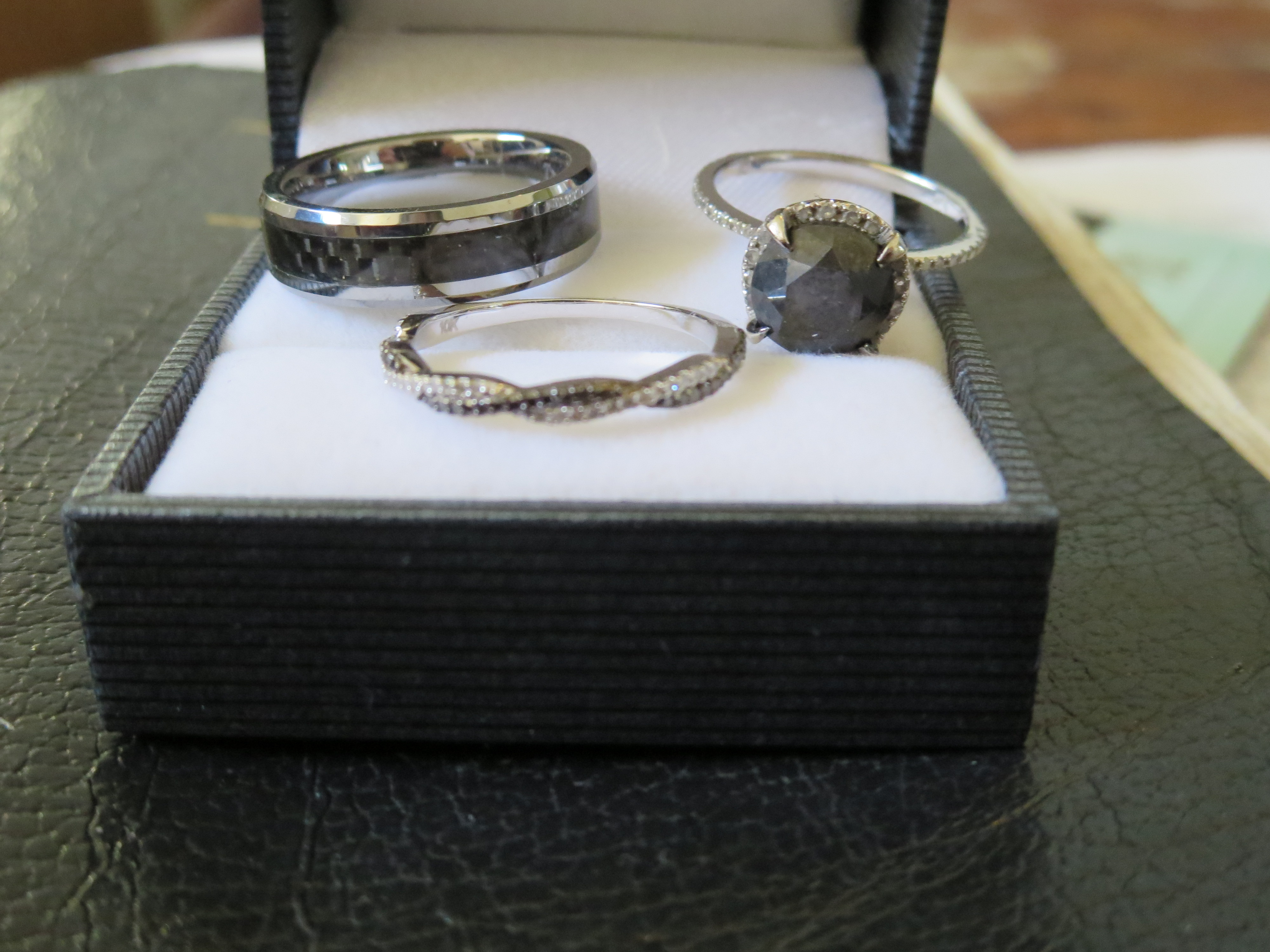 july brides got your wedding bands yet carbon fiber wedding bands Here s our His is band is black carbon fiber My engagement ring is a black and white diamond halo and my band is a black and white diamond twist
