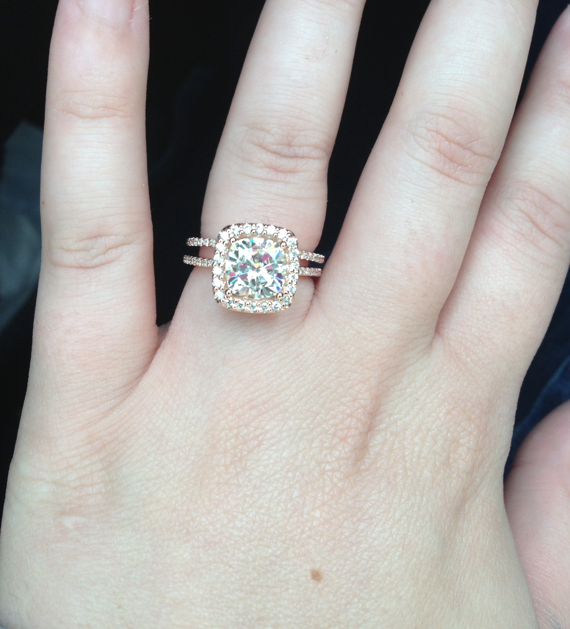 moissanite over diamond all the way mix n match too wedding ring Okay so I am the kinda girl who likes my sparkle and for my 1 year anniversary i knew i wanted to upgrade my ring Love the hubby but the original set