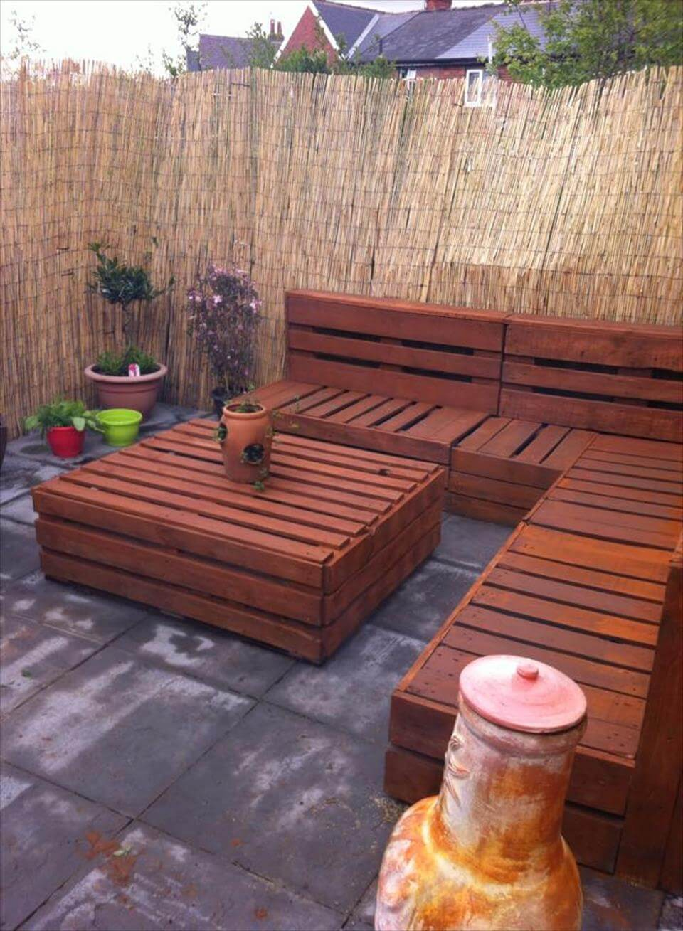 Pallet corner settee for your reed fenced garden