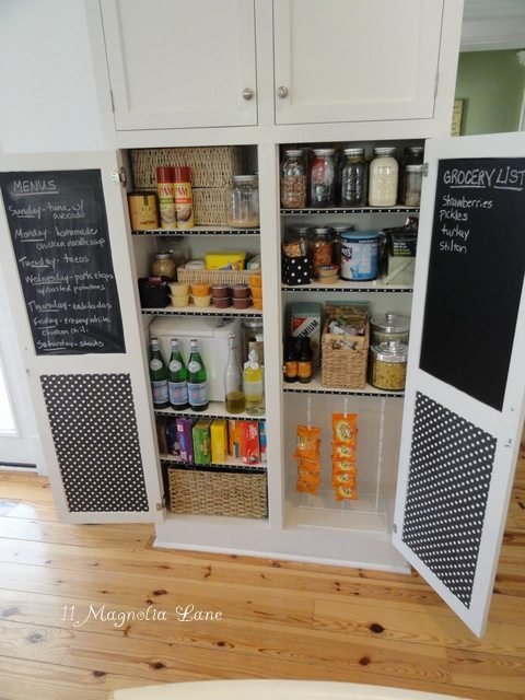 All space used in this cabinet pantry with chalkboard door