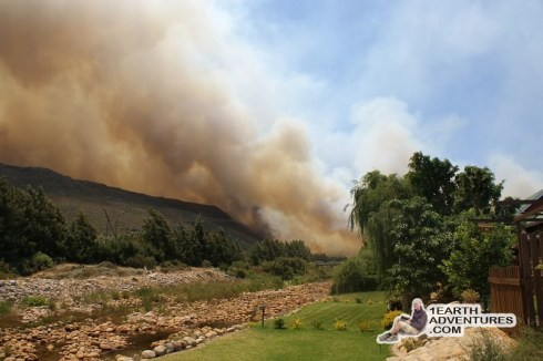 From the bank of the river near the edge of the resort, the fire started burning at the foot of the mountain slope.
