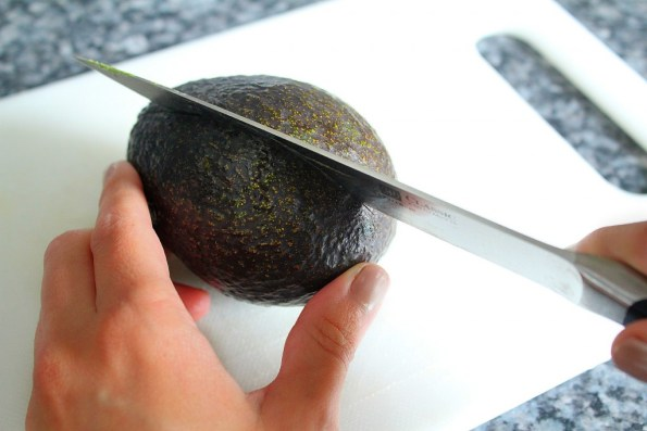 Cut around avocado