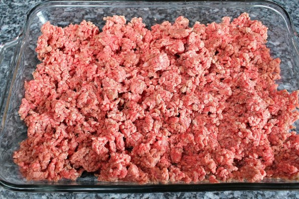 Crumble up ground beef into a casserole dish