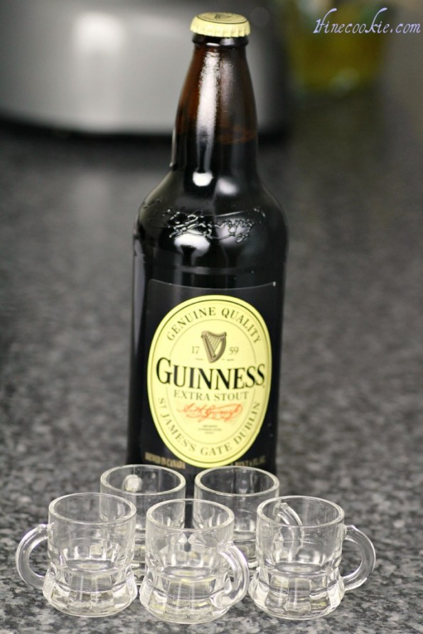 large Guinness, tiny beer mugs