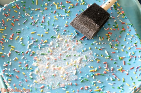 add layers of decoupage on top of sprinkles