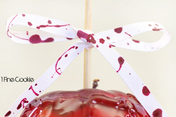 Halloween Craft DIY: Blood Splattered Ribbons horror film, craft, accessory, accessories, ideas, party, table, blood, covered, dripping candied, true blood, halloween, vampire diaries, twilight, ideas, recipes, desserts, theme, themed, white, chocolate, treats, favors, party, table, ribbon, red, black, white, pretty, cute, how to make, diy, vampire, goth, nail polish,