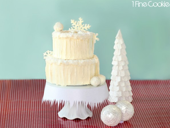 Winter wonderland snowy cake by 1 Fine Cookie, snow, covered, cake, coconut, icicles, sugar, isomalt, winter, wonderland, white, snowflake, glitter, snow, angel, snowball, cake bite, truffle, cake pops. christmas, holidays, vanilla, theme, hanukkah, wedding, icy, sugar, isomalt, tutorial, recipe, shimmer,