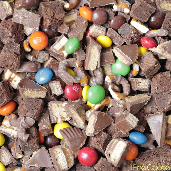 candy 1 Fine Cookie, Chocolate Candy Filled Cheesecake by 1 Fine Cookie, &M's, Snickers, Twix, Reese's Pieces, brownie, bits, chunks, chocolate covered pretzels, Kit Kats, Reese's, peanut butter cups, Oreo cookie crust, chocolate, wafers, oreo, cookie, crust, peanut butter, cheesecake, colorful, leftover, halloween, recipe, what to do with, easy, foolproof, without sour cream, water, bath, classic, best, mini, springform, pan, gold, cake stand, food processor, mixer, hand mixer, birthday, best way to make, how do i,