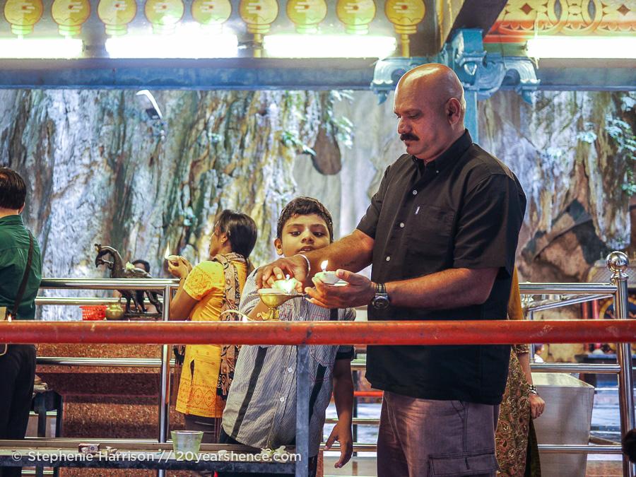 Man with son at Batu Caves