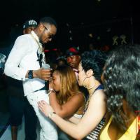 Is D'Banj Having Oral Intercourse With This Female Fan on Stage? - PHOTO