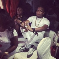 Olamide Turns Sea Captain as He Goes on Boat Ride with Lil Kesh