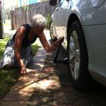 Sheila changing a wheel