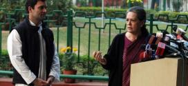 Chief of India's ruling Congress party Sonia Gandhi (R) speaks as her son, lawmaker Rahul Gandhi, watches during a news conference in New Delhi December 8, 2013.