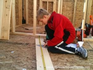 Measuring a board by himself